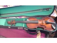 Lovely violin in its own case £40 also black guitar with tuning pipes