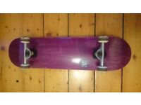 Nearly new ENUFF skateboard and pads
