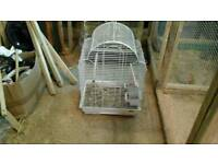 White wire cage in good condition.