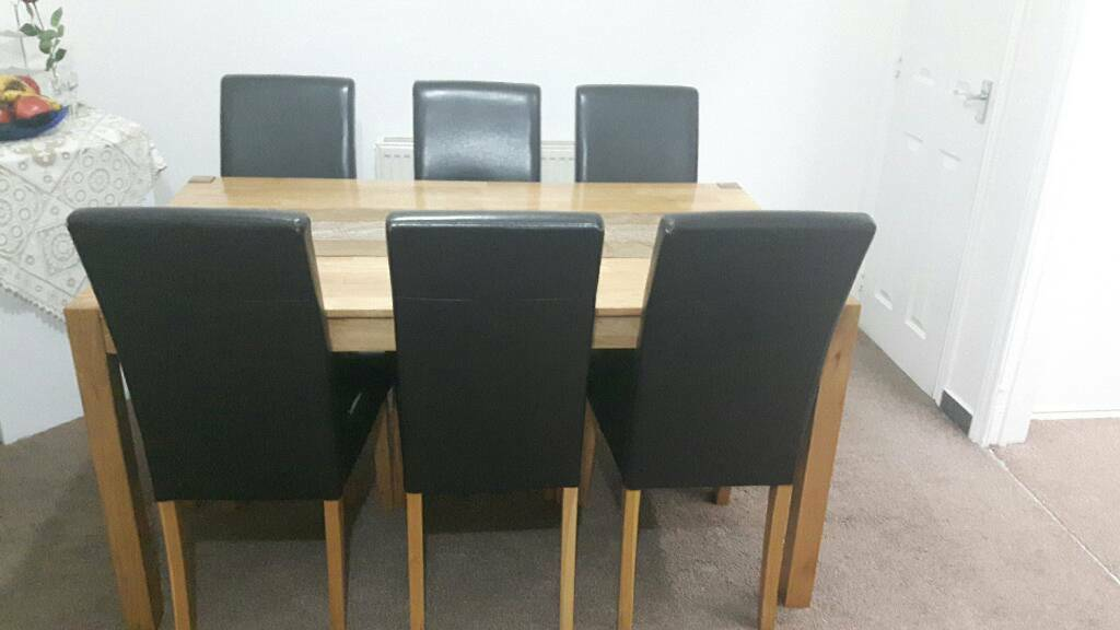 Wooden dinning table and 6 brown leather chairs
