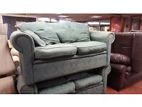 2 X Two Seater Fabric Sofas