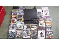 Playstation 3 and lots of games. 2 controllers included. Bargain!