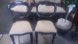 2 ornate vintage chairs.