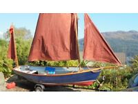 Drascombe Dabber day sailing boat with outboard and trailer. Excellent condition.