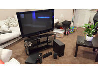 LG 42 inch HD TV with LG surround sound system and Black Glass stand