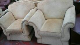 It's a light orange 2 seater sofa with 2 matching chairs