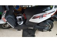 Brand new scooter for sale 49 miles on clock never been in rain first to see will buy 17 plate
