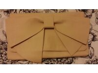 Beige oversized bow clutch