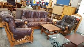 Wooden framed three seater leather sofa with two matching armchairs
