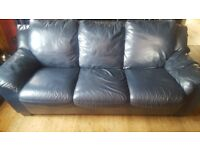 Selling 2 navy leather sofas - to buy together or separately. £25 for 3-seater. £20 for 2-seater.