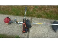 Honda 4 stroke petrol strimmer with harness cost over £400