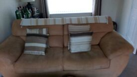 Sandy beige coloured settee and matching single armchair, both in very good condition.