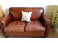 Two seater Leather chair for sale, authentic, good condition.