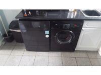 Black washing machine and tumble dryer