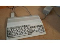 Commodore Amiga 500 with games, extra floppy drive and tv converter