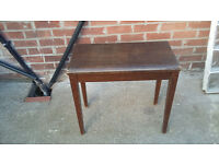 brown wood piano stool with brown leather seat