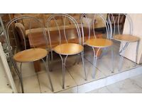 Four Metal framed dinning chairs.