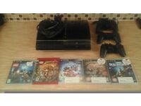 playstation 3 with 5 games and 3 pads