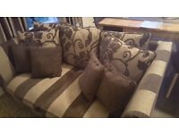 Sofa and single arm chair. Great condition stored in a spare room