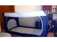 Blue very large travel cot