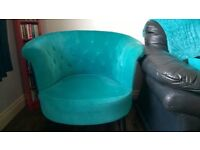 Chesterfield style tub chair in light turquoise with stylish black legs