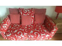 Corner and two seater red/grey material sofa
