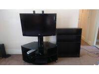 """32"""" LG TV with stand and bookcase"""