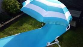 Sun lounger and umbrella