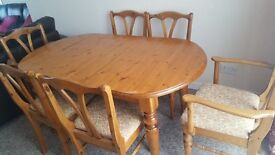 Pine extending dining table with 6 upholstered chairs