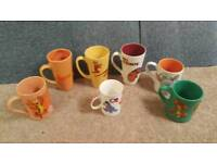 Collection of official Disney trigger mugs