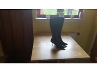 Ladies black leather high heeled boots by M &S. Worn only once. £20