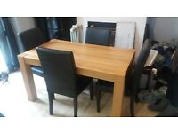 wooden dining table and 4 faux leather chairs