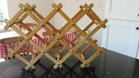 Pine wine bottle rack folding concertina style