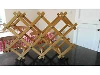 Pine wine bottle rack folding concertina style