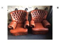 Two Tan Leather Chesterfield Armchairs