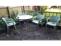 Round glass top metal garden table with umbrella slot for sale NR3