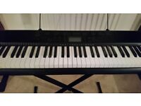 Excellent condition CASIO keyboard piano with stand.