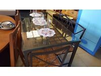 Glass-topped Black Metal Dining Table with Four Metal and Wicker Chairs in Good Condition