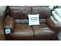 Modern 2 seater leather sofa. BRITISH HEART FOUNDATION