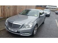 Mercedes E220 with Woking Private Hire Plate