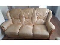 Cream used sofa 3 abd 2 singles. Leather.