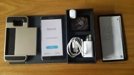SAMSUNG GALAXY S7 EDGE MOBILE PHONE. INCLUDES ORIGINAL BOX. CHARGER. EAR PHONES & CASE