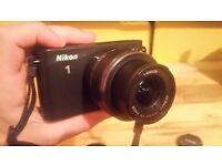 Nikon J1 Camera (With Carry Bag, Charger, Lens + SD Card)