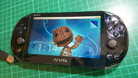 Sony Playstation Vita 64GB Wi-Fi Model - Complete Mega Bundle with +50 games,Lanyard and Travel Case