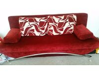 Red sofa bed. Good condition. Few scratches. 205cm long.