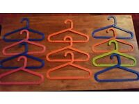 Childrens brightly coloured plastic coat hangers great for fancy dress outfits