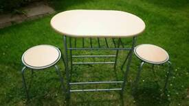 Breakfast table and two stools