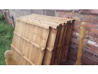 Unused fence panels, concrete gravel boards and concrete posts
