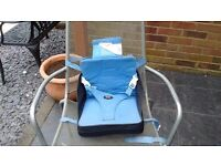 Blue inflatable travel booster seat