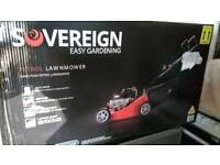 Brand new sovereign petrol lawn mower unused still in sealed box.